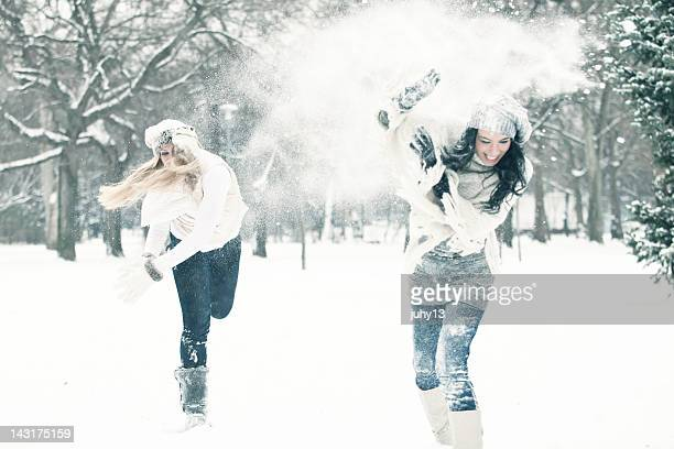 Two women having a snow ball fight