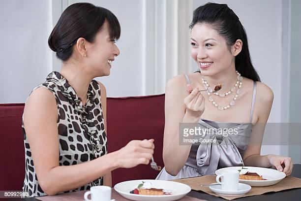 Two women having dessert