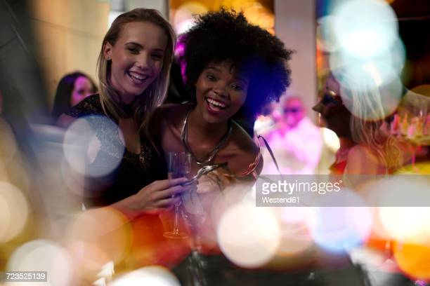 Two women having fun on a party