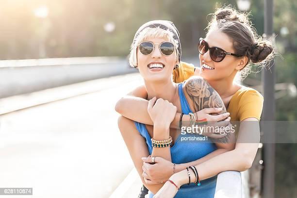 Two women having fun on bridge