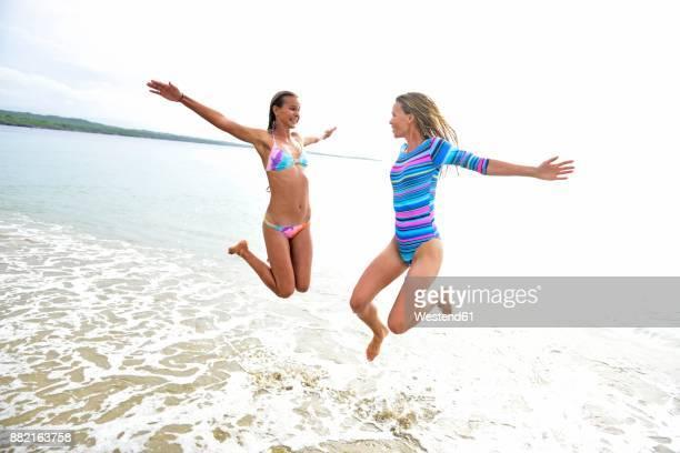 Two women having fun on the beach