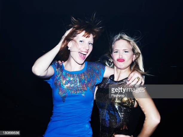two women having fun together on night out - puckering stock pictures, royalty-free photos & images