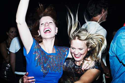 Two women having fun together on night out - gettyimageskorea