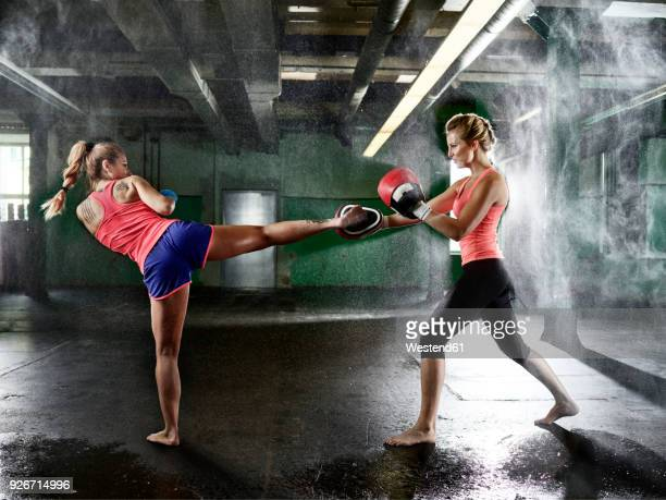 Two women having martial arts training