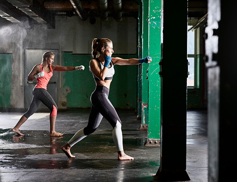 Two women having martial arts training - gettyimageskorea