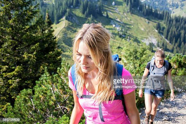 Two women hiking in mountain landscape