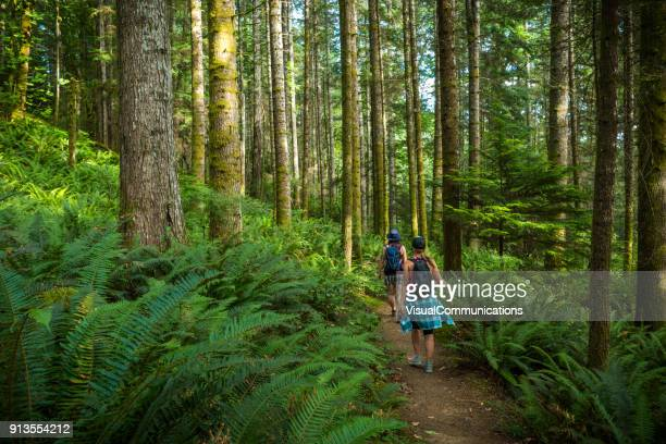 two women hiking ripple rock trail on vancouver island. - vancouver island stock pictures, royalty-free photos & images
