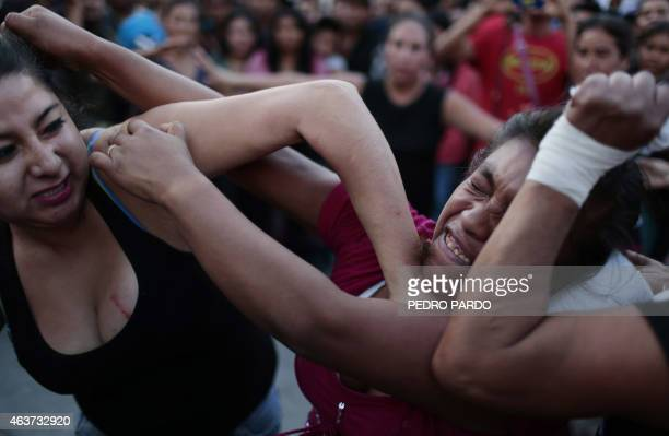 Two women hit each other in a fight representing the Xochimilcas fight to defend their women against the Aztecs in the Mexican municipality of...