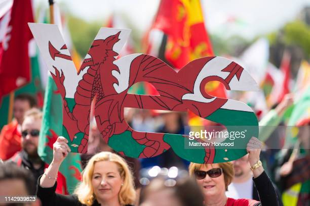 Two women hold a Yes sign as thousands take part in the first ever march for Welsh independence from City Hall to the Hayes on May 11, 2019 in...