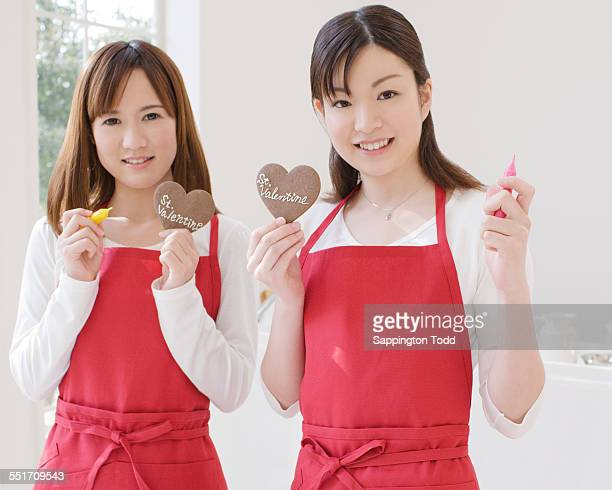 Two Women Holding Cookies