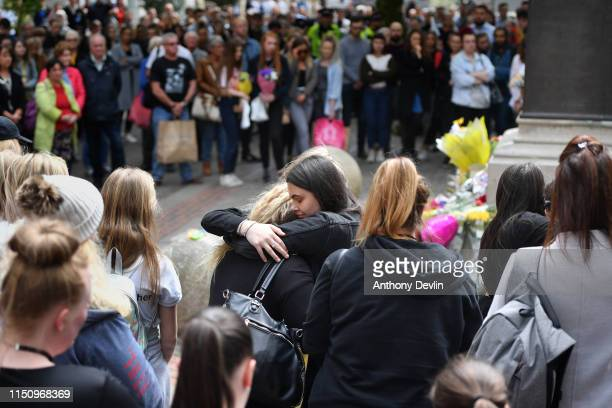 Two women hug during a two minute silence is observed in memory of the victims of the Manchester Bombing in Saint Anne's Square on May 22, 2019 in...