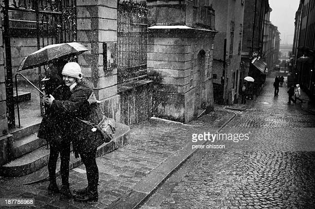 CONTENT] Two women hugging in the rain