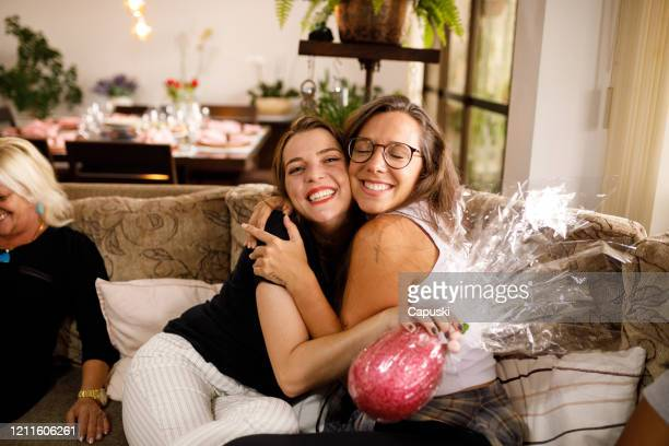 two women hugging on easter celebration - easter stock pictures, royalty-free photos & images