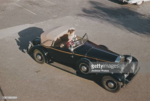 Two women in a 1934 Hispano Suiza Drophead Coupe with a 12cylinder engine December 1958 It is part of the Carriage Cavalcade automobile collection at...