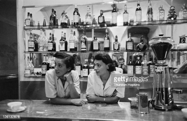 Two women in a bar in the Tuscan hill town of San Gimignano Italy August 1955 Original publication Picture Post 7958 Open Air Theatre unpub