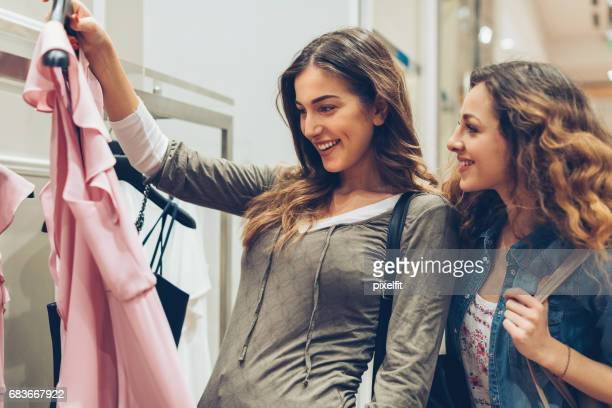 two women in a fashion store - society beauty stock pictures, royalty-free photos & images