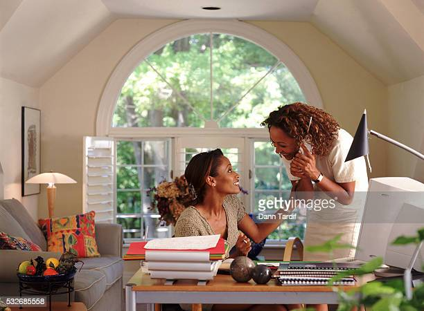 Two women in a home office
