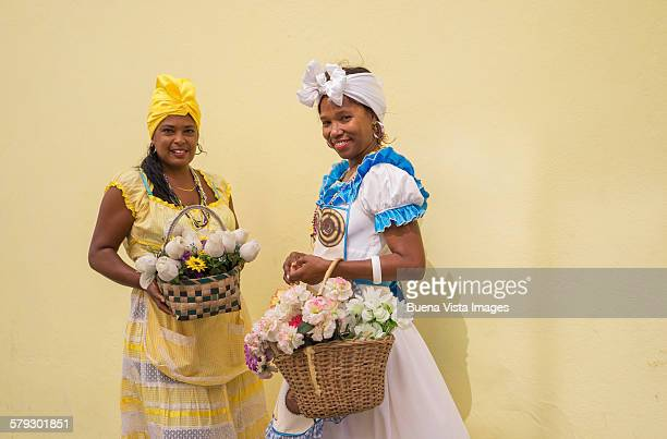 Two women in a traditional cuban dress