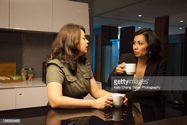 Two women in an office pantry