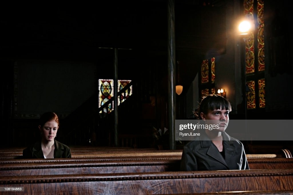 Two Women in an Old Church Cathedral : Stock Photo