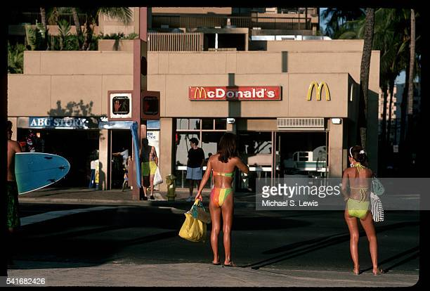two women in bikinis - mcdonald's stock pictures, royalty-free photos & images