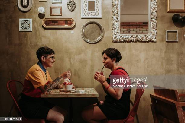 two women in cafe - lesbian dating stock pictures, royalty-free photos & images