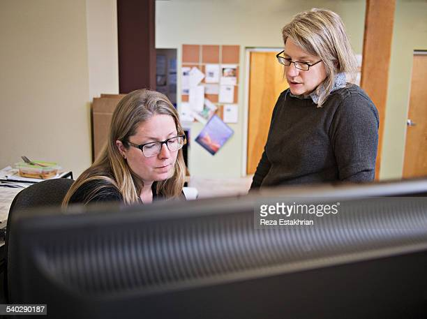 Two women in discussion at desk