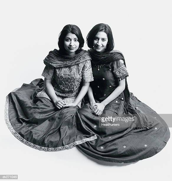 two women in long dresses, posing on floor - headhunters stock pictures, royalty-free photos & images