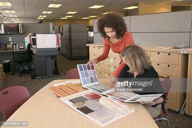 Two women in office looking at swatches