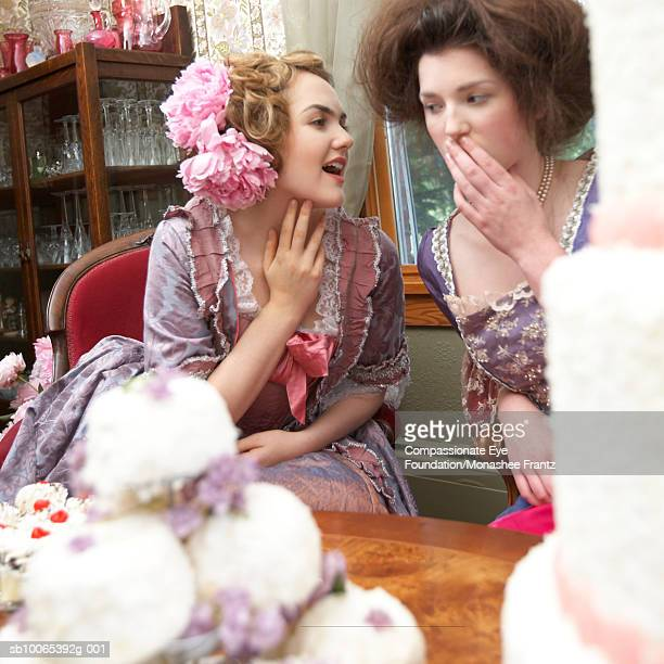 "two women in period dress talking - ""compassionate eye"" stock pictures, royalty-free photos & images"