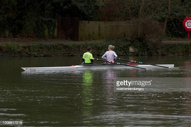 two women in racing boat - oxfordshire stock pictures, royalty-free photos & images