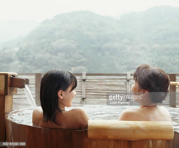 Two women in spa, rear view