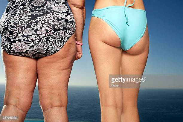 two women in swimsuits - chubby legs stock photos and pictures