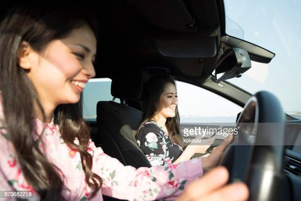 two women in the car - asian twins stock photos and pictures