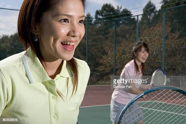 Two women in the same tennis team