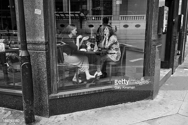 Two women in the window of a Pizza Express restaurant in Central London