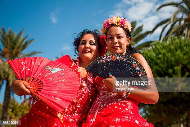 two women in traditional costume outside cathedral - traditional clothing stock pictures, royalty-free photos & images