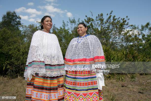 Two women in traditional dress at the Big Cypress Shootout event at Billie Swamp Safari