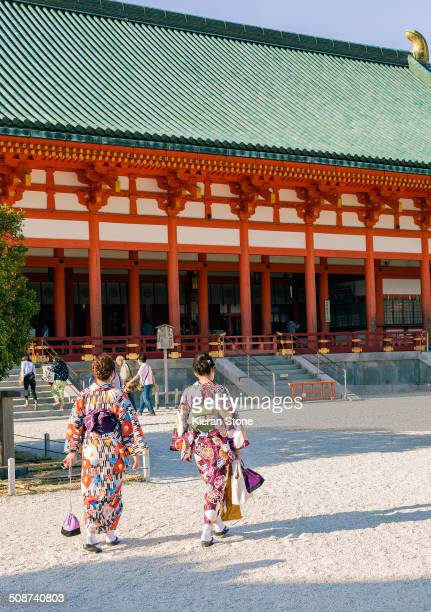 Two women in traditional Kimono in front of the Heian shrine in Kyoto.