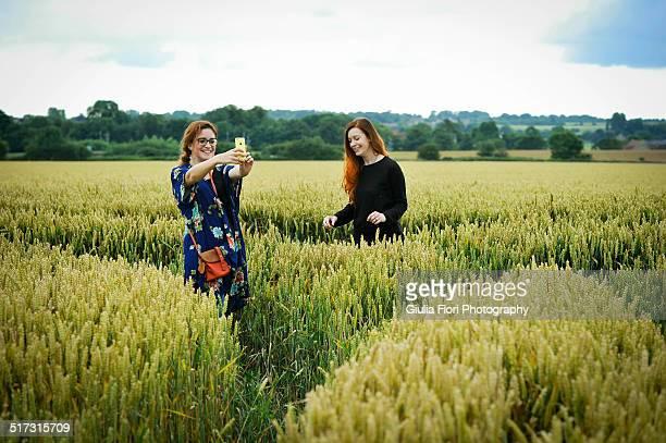 Two women in wheat field