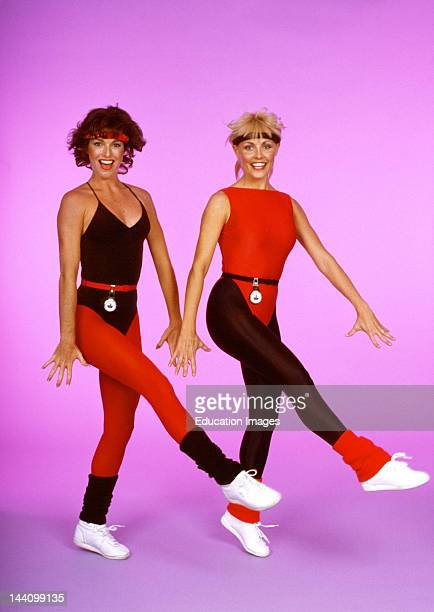 Two Women In Workout Clothes Doing Aerobics.