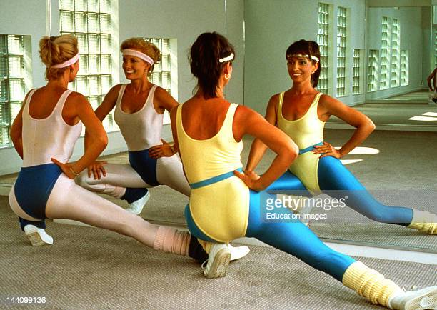 S Two Women In Workout Clothes Doing Aerobics