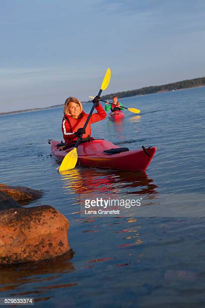 Two women kayaking on the sea