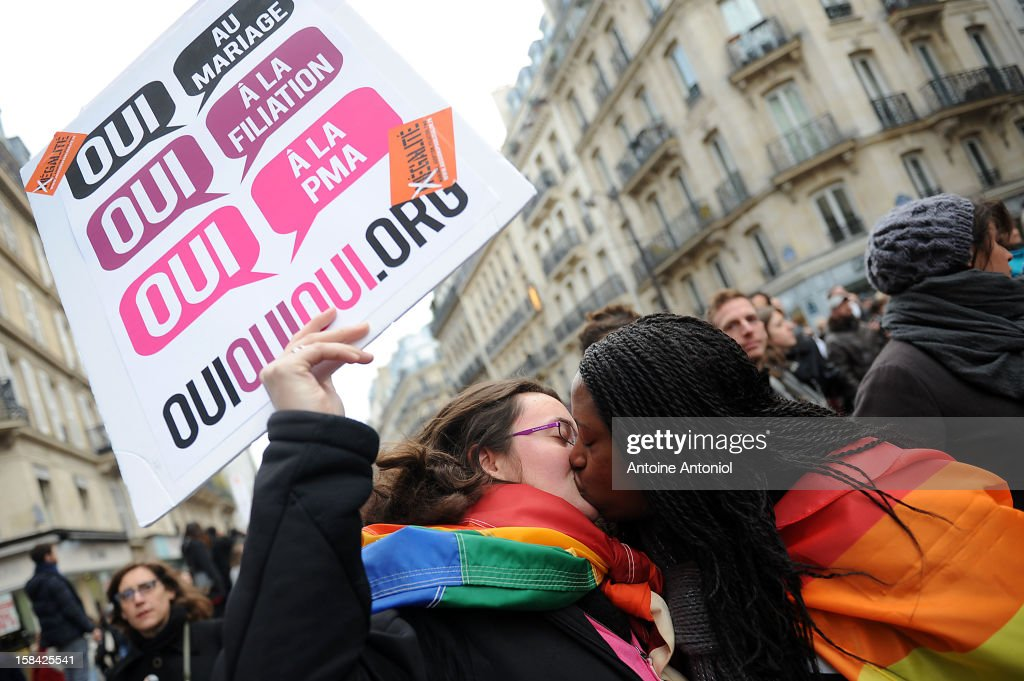 Two women kiss during a demonstration for the legalisation of gay marriage and parenting on December 16, 2012 in Paris, France. Demonstrations have shown a deep division in French society over the marriage equality bill expected to be passed in early 2013. The bill would not only legalize same-sex marriage but would also allow gay couples to adopt, which is seen as the most controversial issue. French President Francois Hollande, who has supported the legislation, is facing criticism from anti-gay and religious groups, while gay rights groups have warned of inadequacies within the bill.