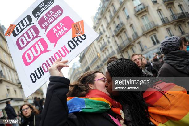 Two women kiss during a demonstration for the legalisation of gay marriage and parenting on December 16 2012 in Paris France Demonstrations have...