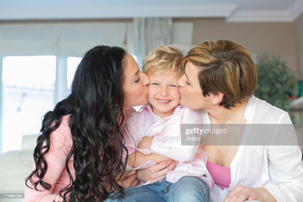 Two women kissing a cute little boy stock photo getty images two women kissing a cute little boy stock photo thecheapjerseys Gallery