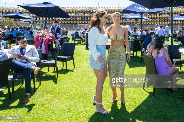 Two women laugh during Bentley Cup Day at Royal Randwick Racecourse on November 03, 2020 in Sydney, Australia. The Melbourne Cup is Australia's...