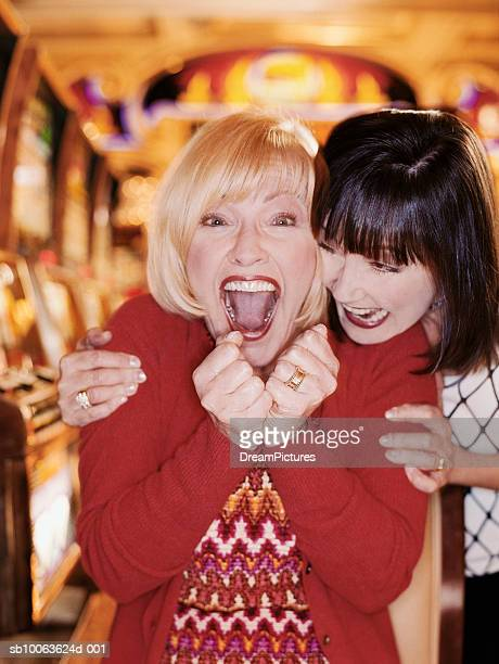 two women laughing in casino - exceed and excel stock pictures, royalty-free photos & images