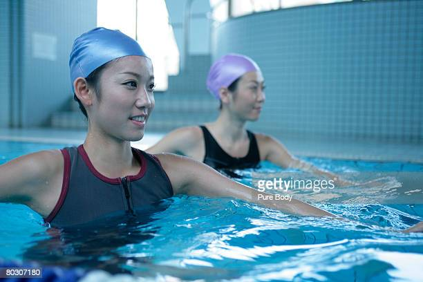 Two women learning how to swim