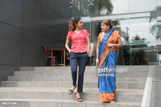 two women leaving office building, mature woman in sari - sri lankan culture stock pictures, royalty-free photos & images